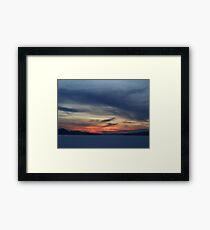 The orange sunset is fading in the blue night skye Framed Print