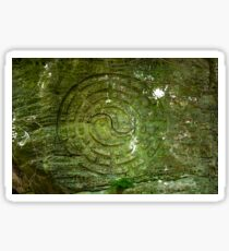 Buddhist symbol overgrown with moss rock carved Buddhist monks in India Sticker