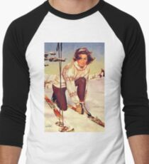 Young woman tie down her ski on a winter day T-Shirt