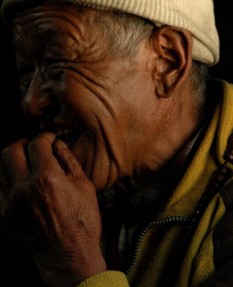 Grandfather in inn, near Gyapla, Eastern Nepal, 2005. by John Shortt-Smith