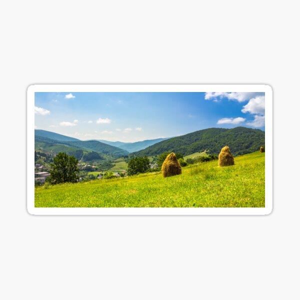 haystacks on hillside near the village Sticker