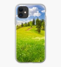 few trees on hillside meadow iPhone Case