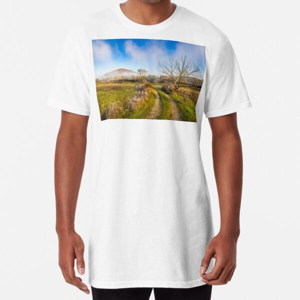 rural landscape with road through agricultural meadow in fog Long T-Shirt