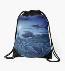 boulders on the mountain meadow with dandelions at night Drawstring Bag