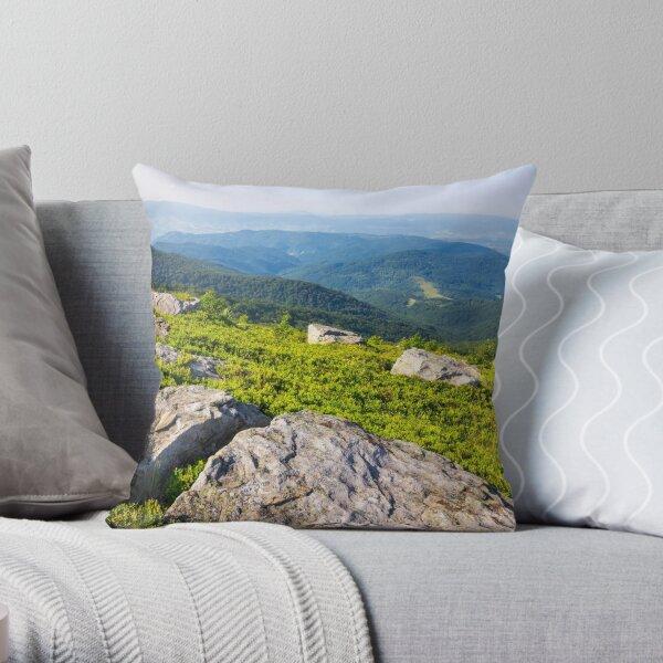 light on stone mountain slope Throw Pillow