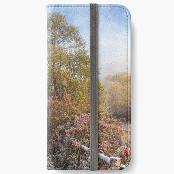 wooden fence in fog on frozen meadow at sunrize iPhone Wallet