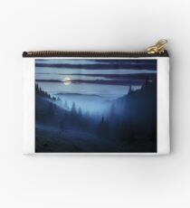 fog around the mountain top at night Studio Pouch