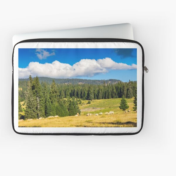 flock of sheep on the meadow near  forest in mountains Laptop Sleeve