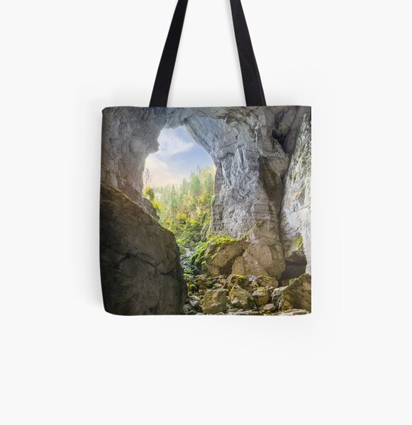 Cetatile cave sculpted by river in romanian mountains at sunrise All Over Print Tote Bag