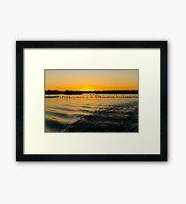 Golden Sunset Over Water Framed Print