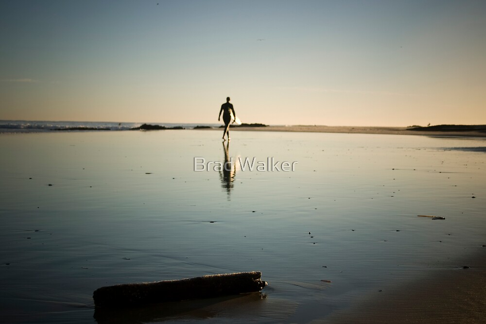 Surfer sighting his next wave by Brad Walker