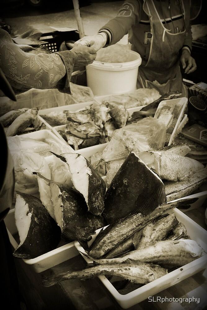 Fishmonger by SLRphotography