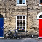 Blue and red doors by Ana Andres-Arroyo