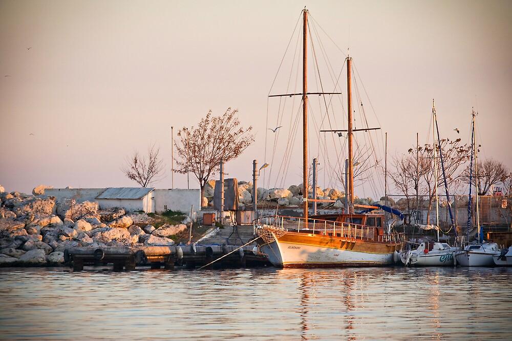 Boat at sunset by Dogan Eskiyoruk