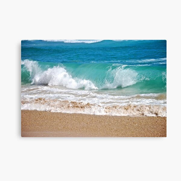 Wave breaking on the beach Canvas Print