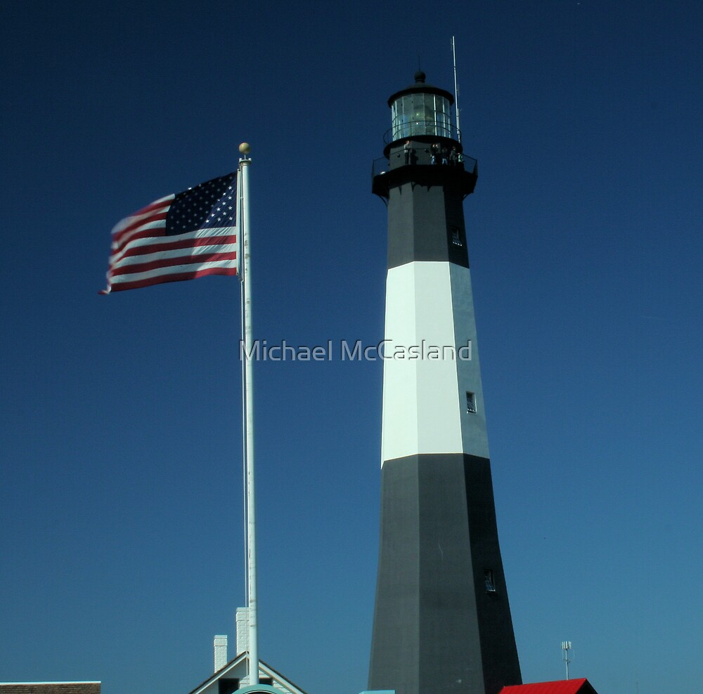 Lighthouse and American Flag Waving by Michael McCasland