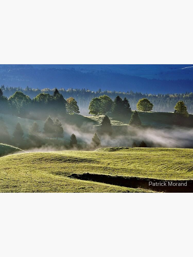 Mist and sun on Jura landscape by patmo