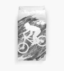 Funda nórdica Silueta de un ciclista en una bicicleta de montaña