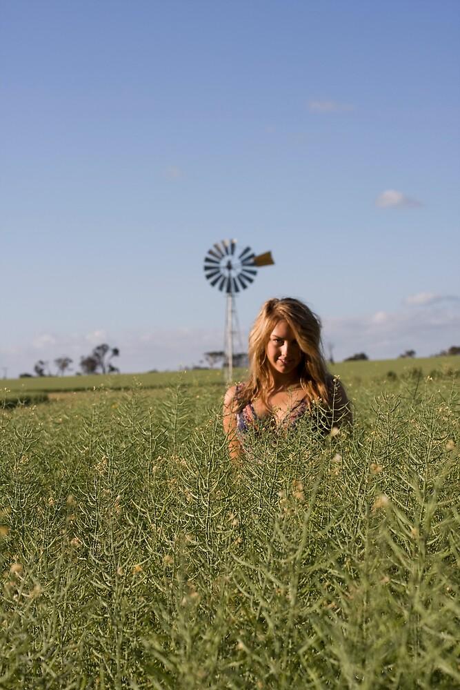 Woman in fields by Robbie Gibson