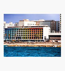 Israel, Tel Aviv coast line and cityscape dominated by the colourful facade of the Dan Hotel by Agam Photographic Print