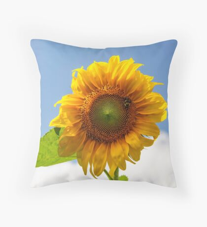 A busy bee on a Sunflower Throw Pillow