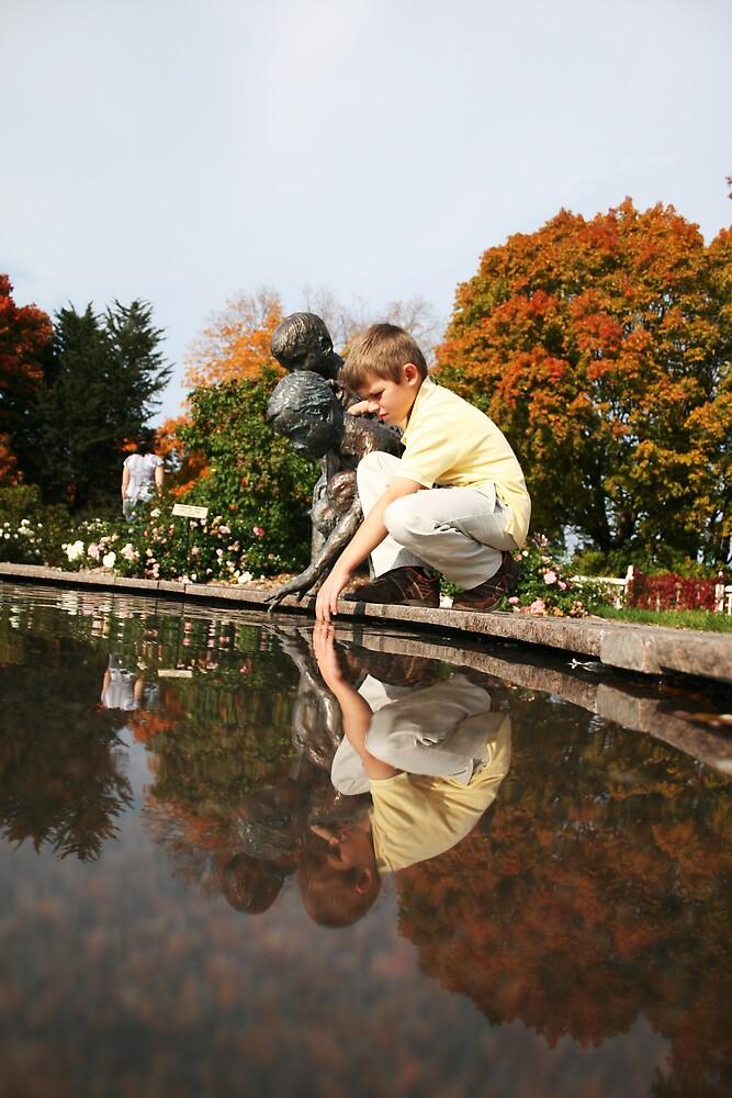 reflection of a boy by Kris Z