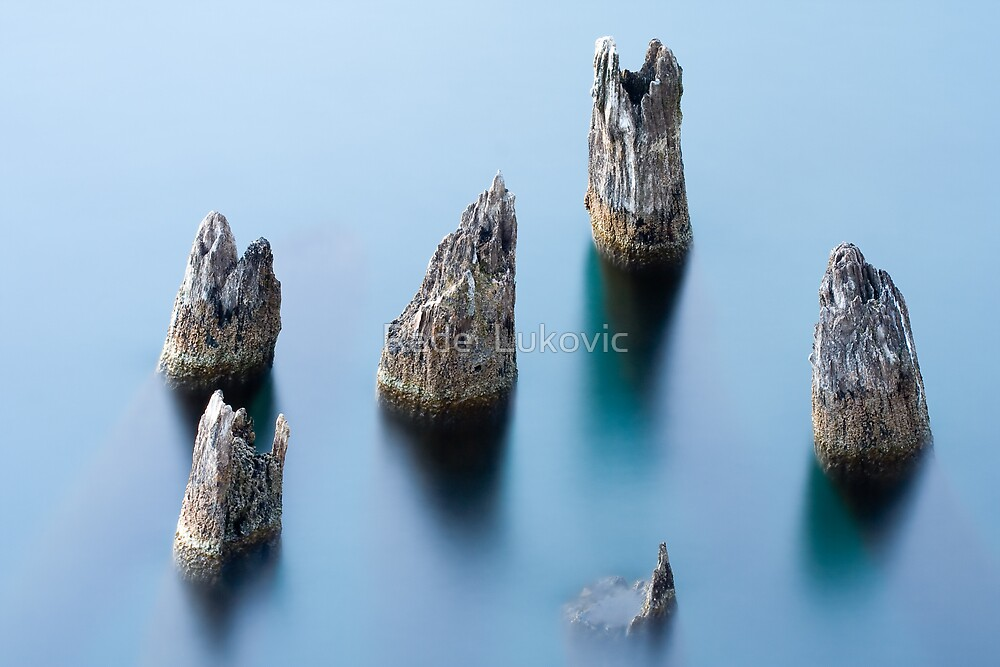 Rocks in water by Rade  Lukovic