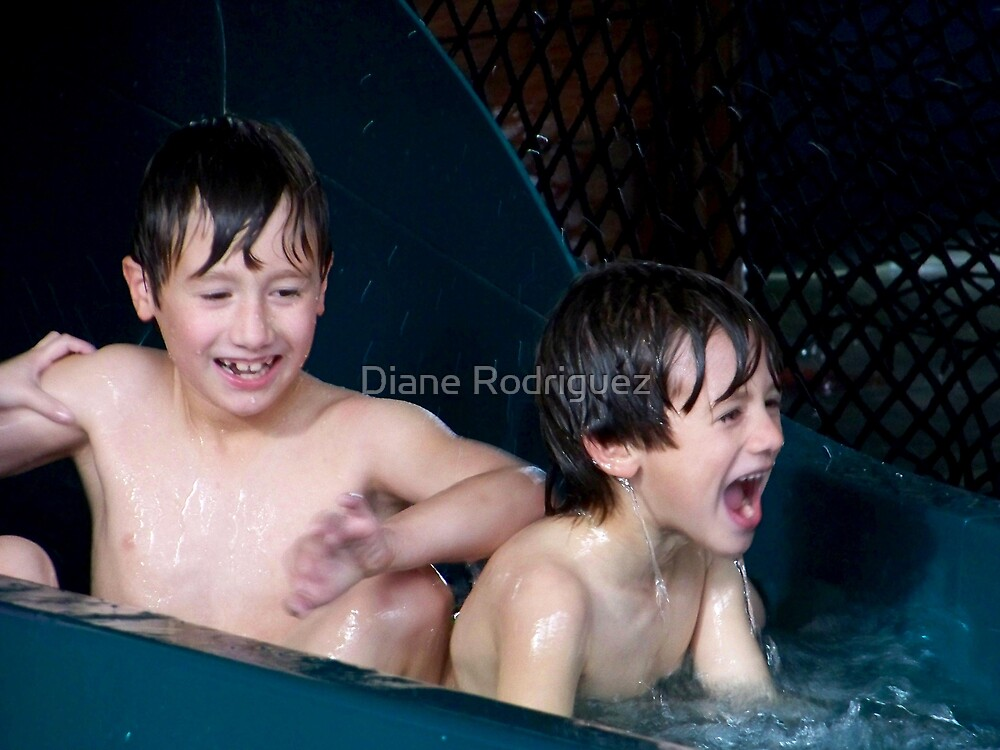 Boys coming down the water slide. by Diane Rodriguez