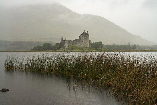 The ruins of historic Kilchurn Castle and view on Loch Awe by Catuncia