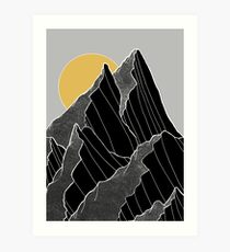 The dark peaks under the golden sun Art Print