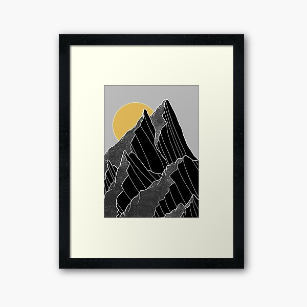 The dark peaks under the golden sun Framed Art Print