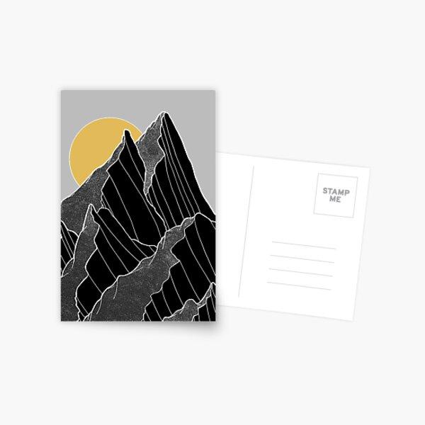 The dark peaks under the golden sun Postcard