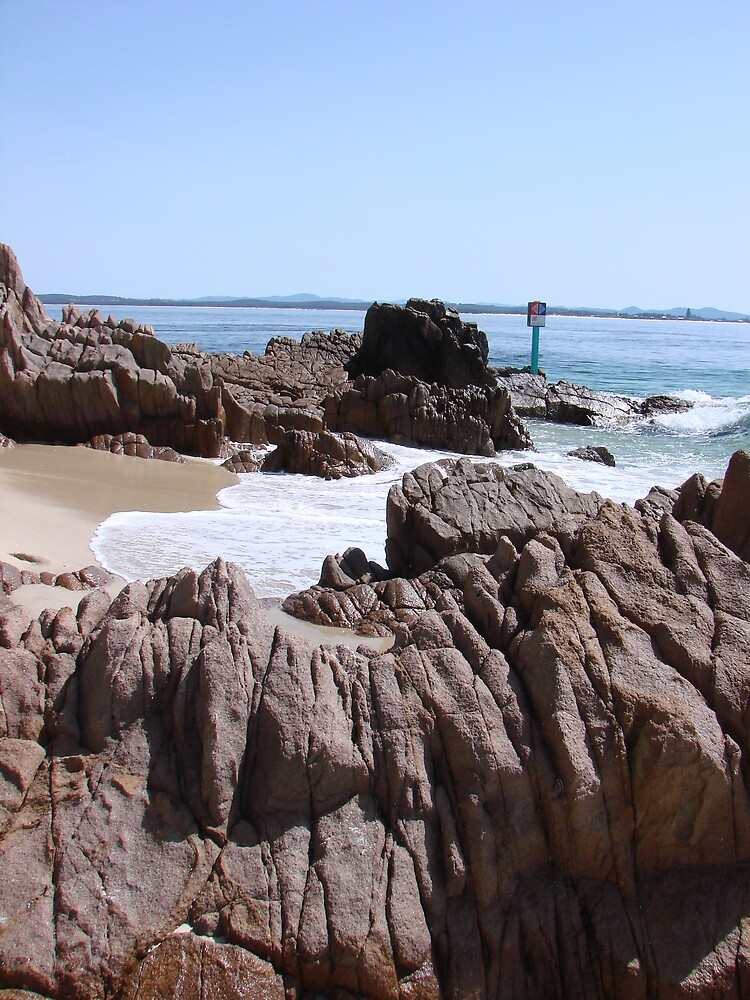 rocks at the beach by fontmedia