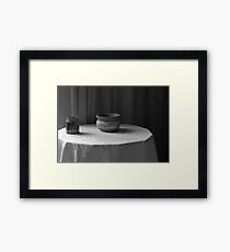 Glass jar and earthenware bowl on a table Framed Print