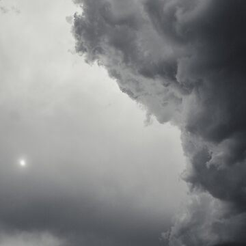 Sun behind the storm clouds by martinbenito