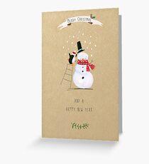Penguin Decorating Snowman Greeting Card