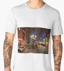 Snow-covered street cafe tables on winter street, Strasbourg, Christmas time. Night scene with highlighted old buildings. Tourisitic concept. France. Men's Premium T-Shirt