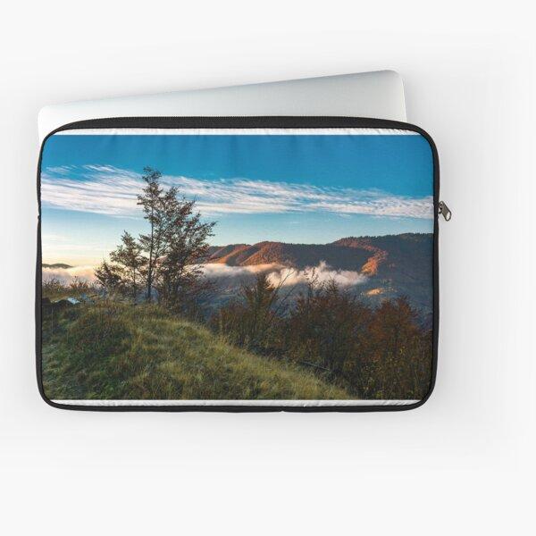 foggy sunrise in mountainous countryside Laptop Sleeve
