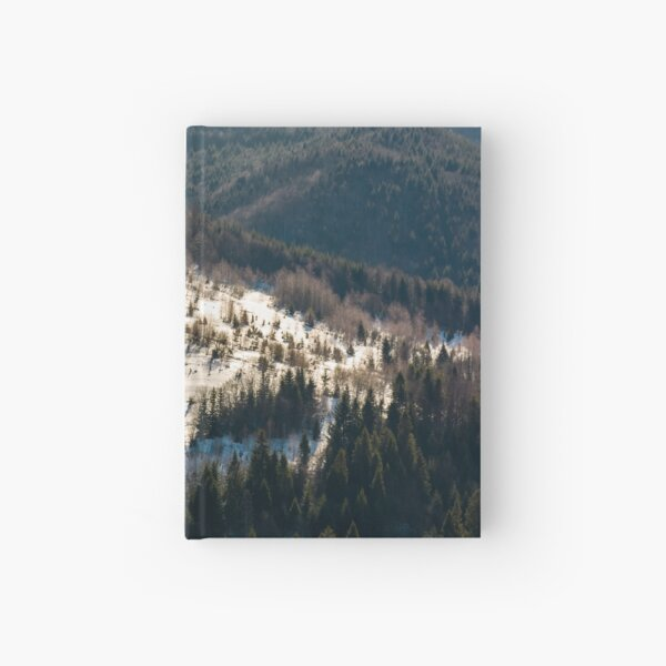 snow covered meadow among forest on hillside Hardcover Journal