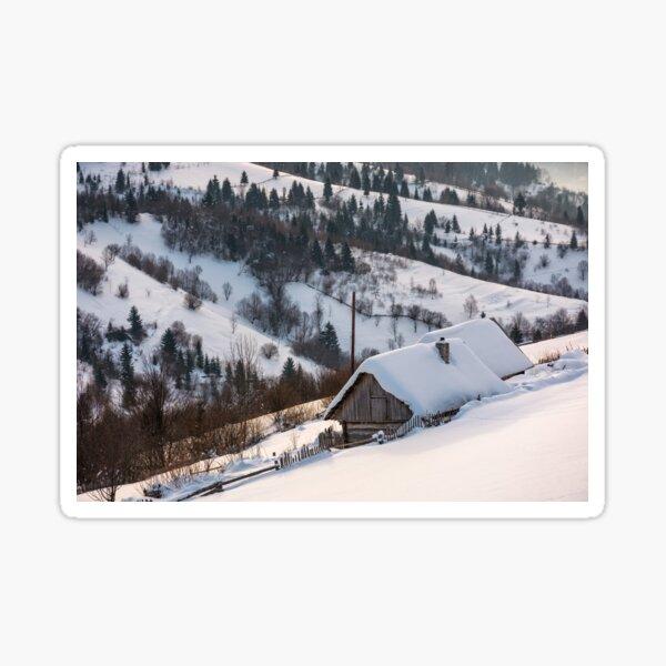 woodshed on hillside in deep snow Sticker
