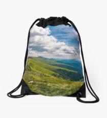 gorgeous cloudscape over stunning landscape Drawstring Bag