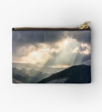 beams of light over the mountains Studio Pouch