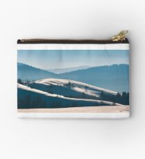 gorgeous winter panorama of rolling hills Studio Pouch