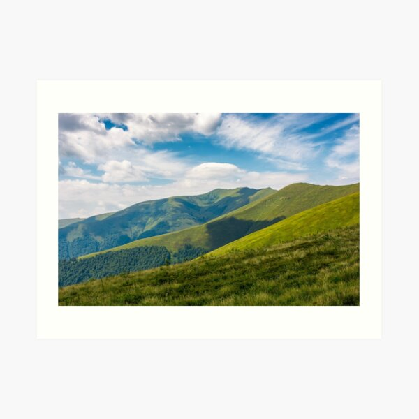 grassy slopes under the cloudy sky Art Print