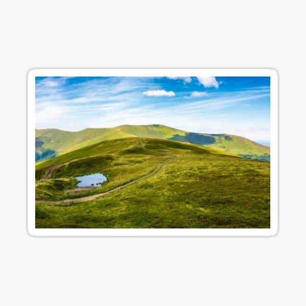 little pond on top of mountain ridge Sticker