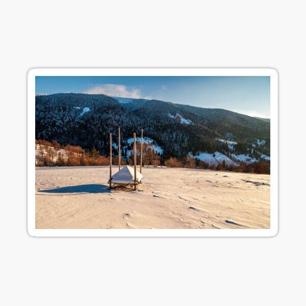 empty haystack shed on snowy hillside Sticker