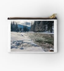 cold flow of forest river in snowy spruce forest Studio Pouch