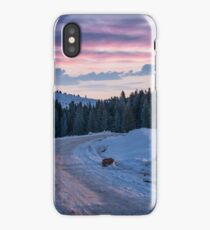 road through snowy hill side in to the forest iPhone Case/Skin
