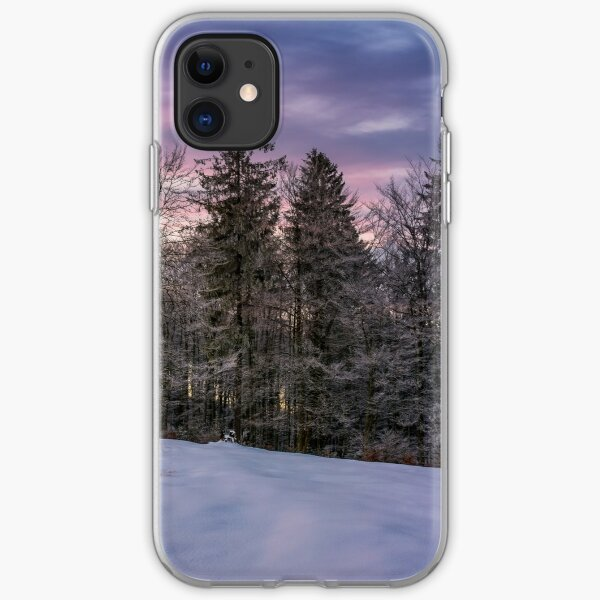 forest in hoarfrost on snowy hillside at dawn iPhone Soft Case