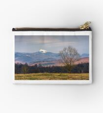 leafless trees on grassy hillside in mountains Studio Pouch